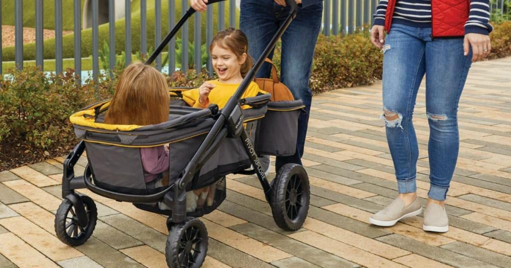 little girls in a stroller wagon