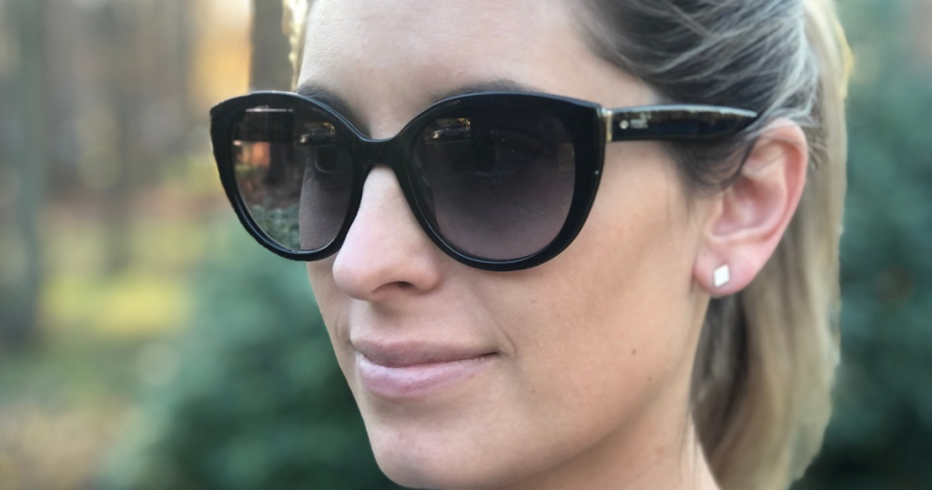 woman wearing black fossil sunglasses