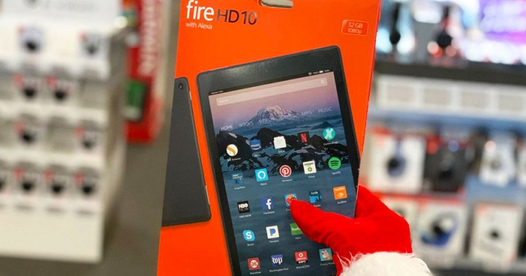 hand in santa glove holding up orange box for fire HD 10 tablet