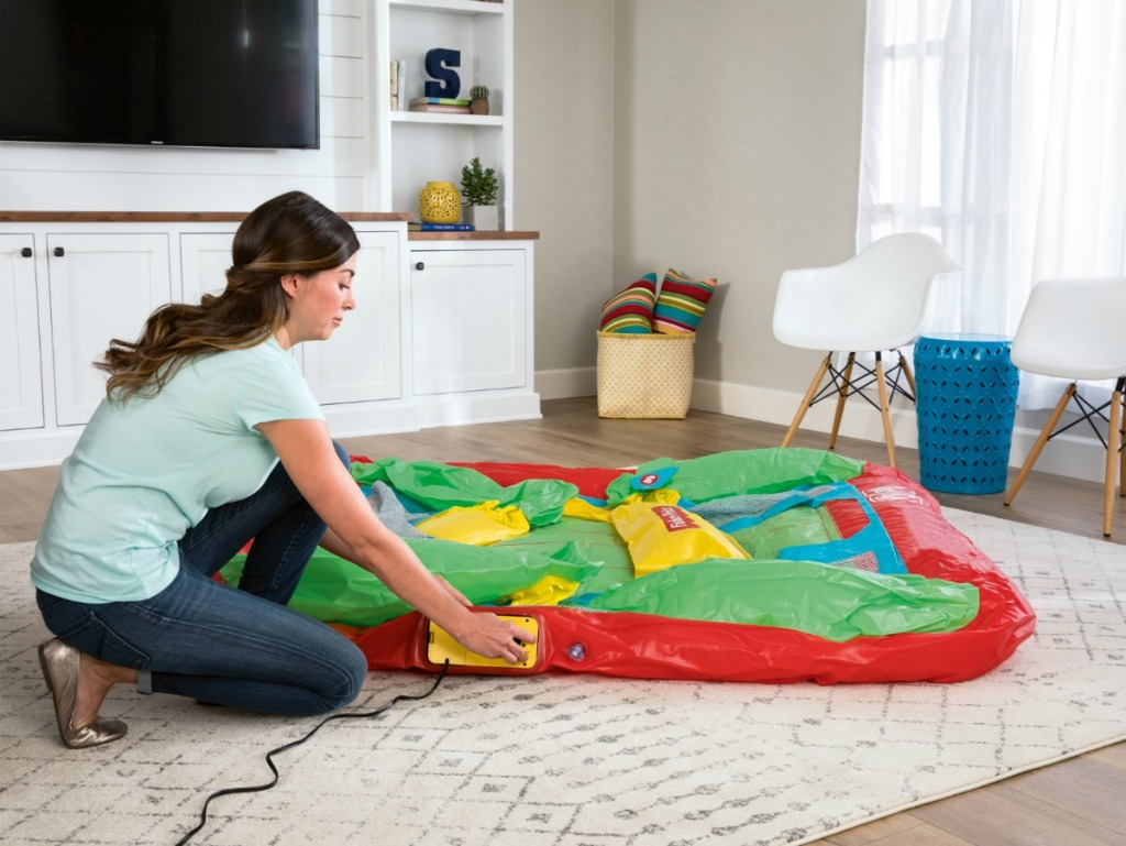 woman deflating Fisher-Price Bouncesational Bounce House