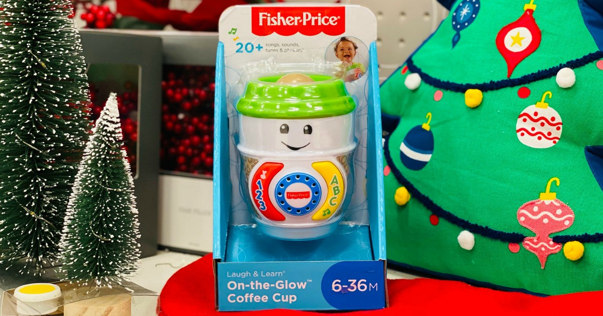 Fisher-Price Coffee Cup toy in packaging next to Christmas tree decorations