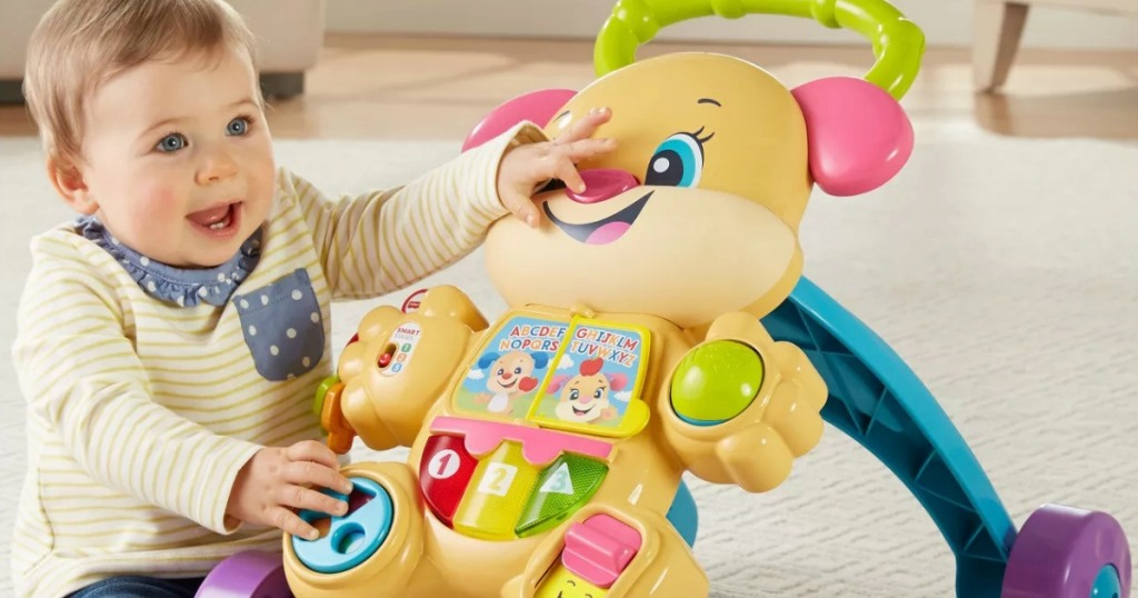 baby with fisher-price puppy walker