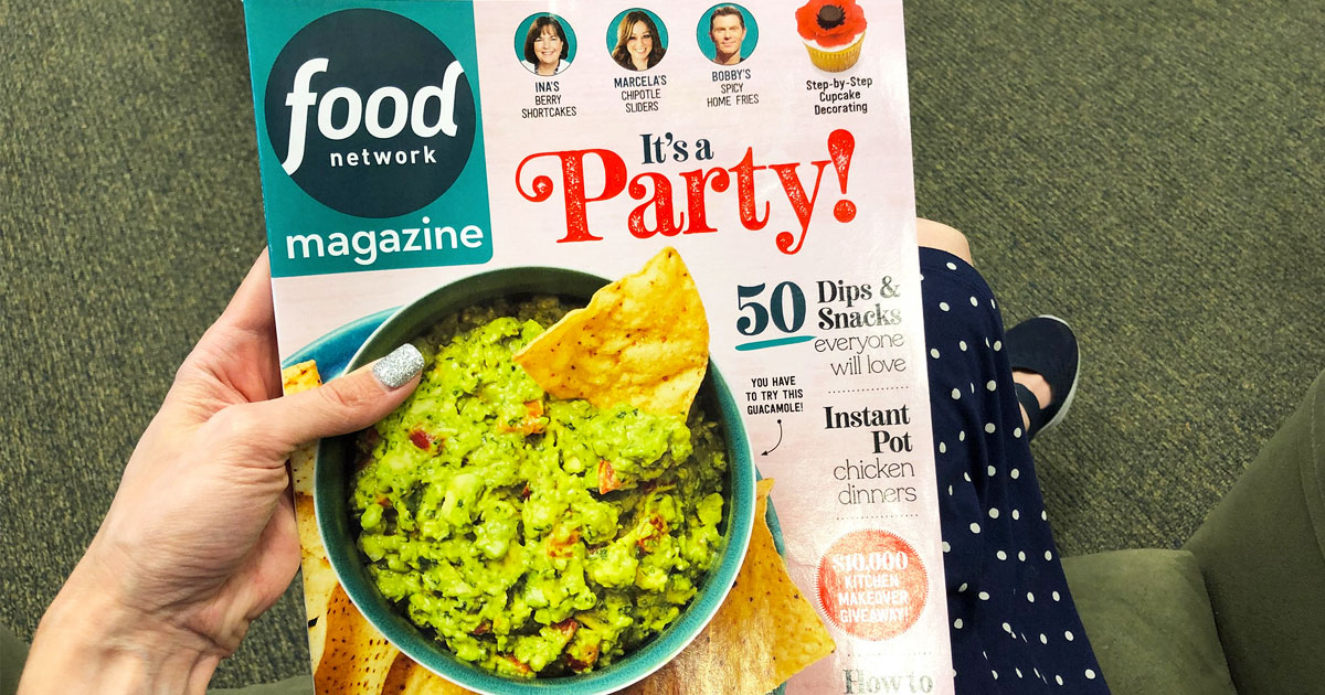 woman holding up a copy of food network magazine with bowl of guacamole on the cover
