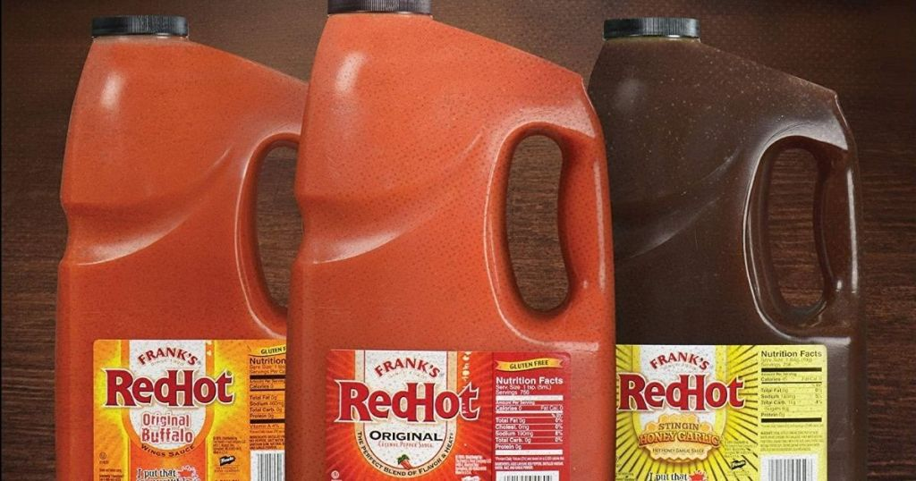 three containers of Frank's RedHot sauce