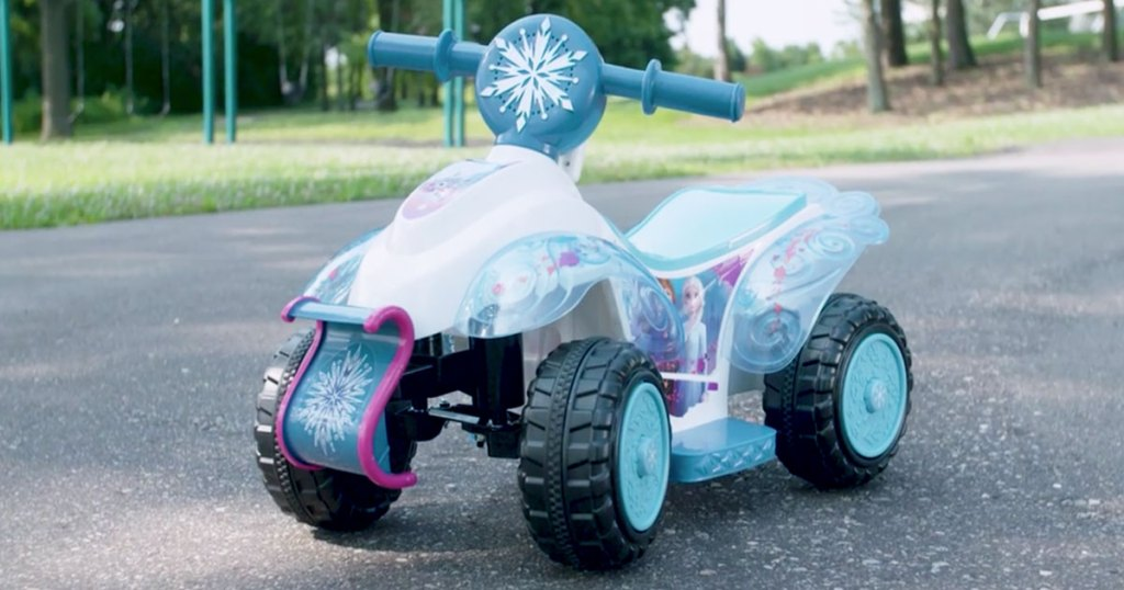 blue and white disney frozen themed kids ride-on quad toy on street