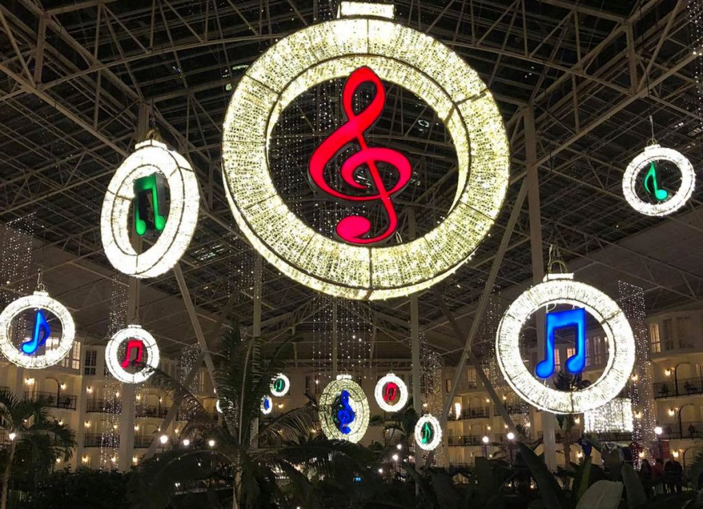 music notes hanging from ceiling lit up in christmas lights at Gaylord Opryland hotel