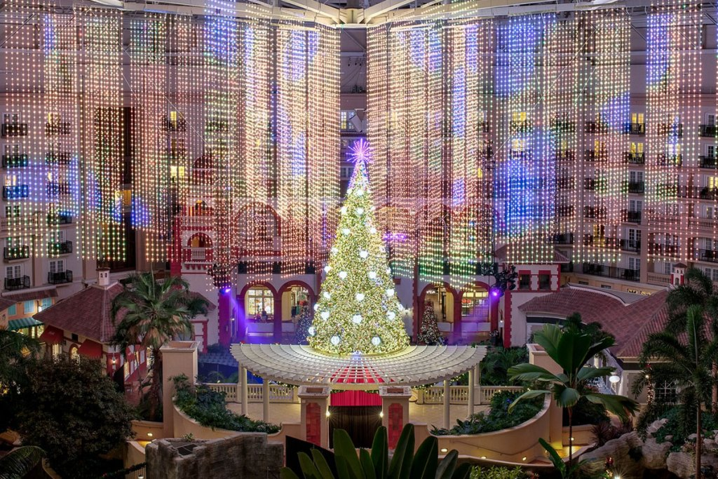 large christmas tree with srings of white lights hanging from ceiling at Gaylord Palms hotel