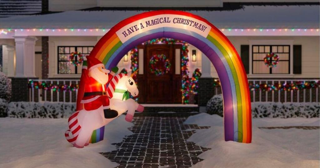 inflatable rainbow arch in front of a house