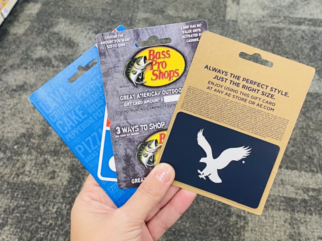 hand holding gift cards in store