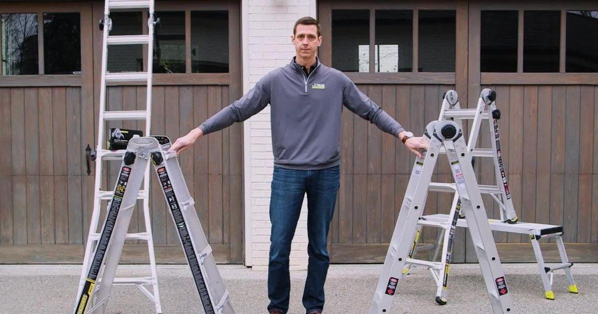 Man with four Gorilla eighteen foot ladders in front of garage doors
