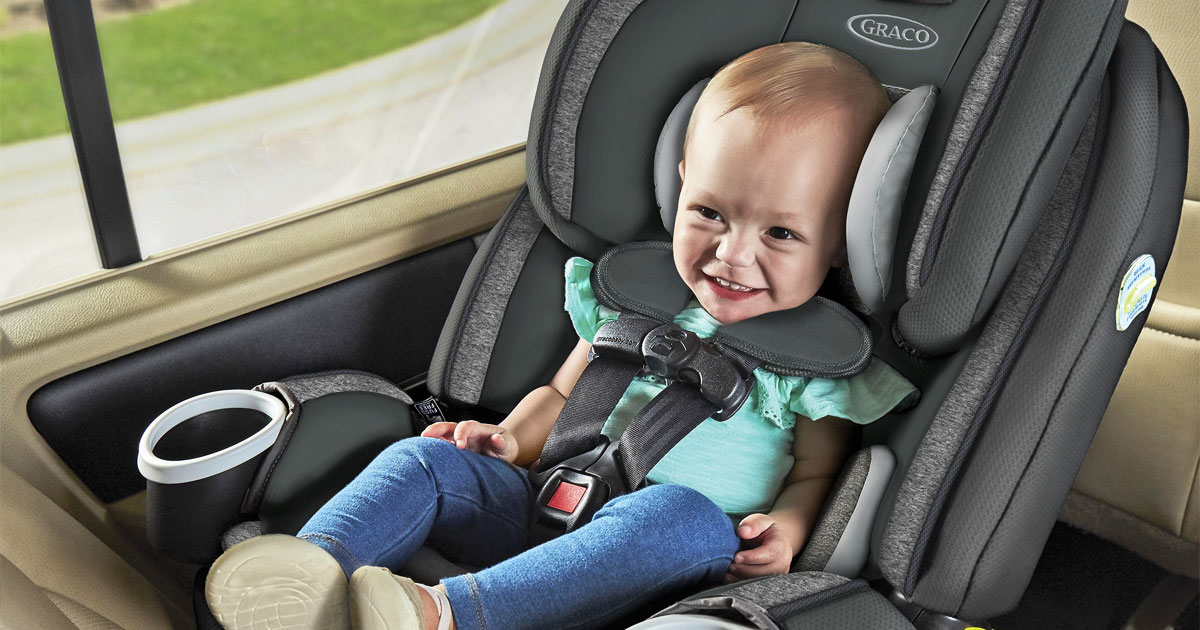 baby sitting in a grey and black graco car seat