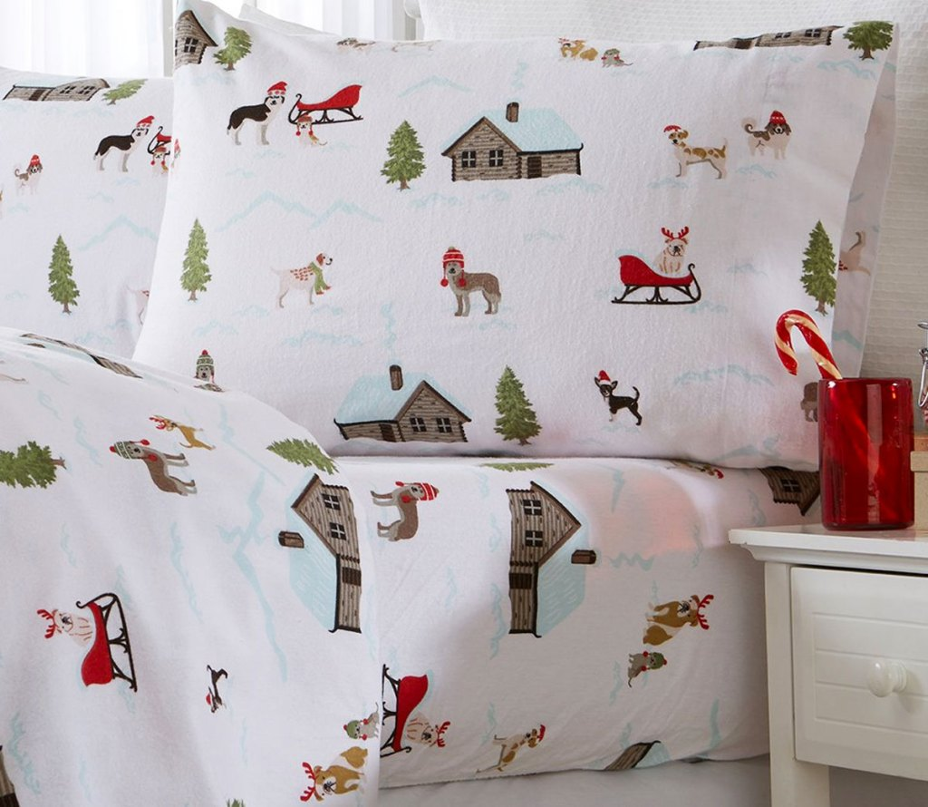 bed made with white flannel sheet set with log cabins and christmas dog print