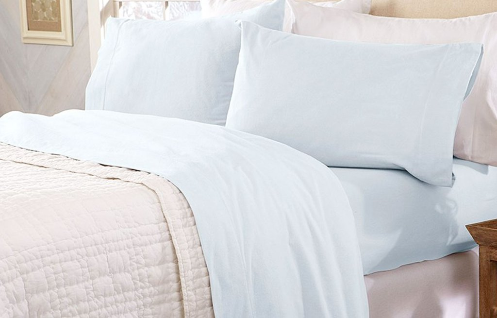 bed with light blue flannel sheet with with two matching pillow cases