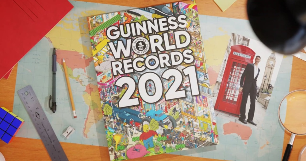 Guinness World Record book on table with ruler, pencil, and pen