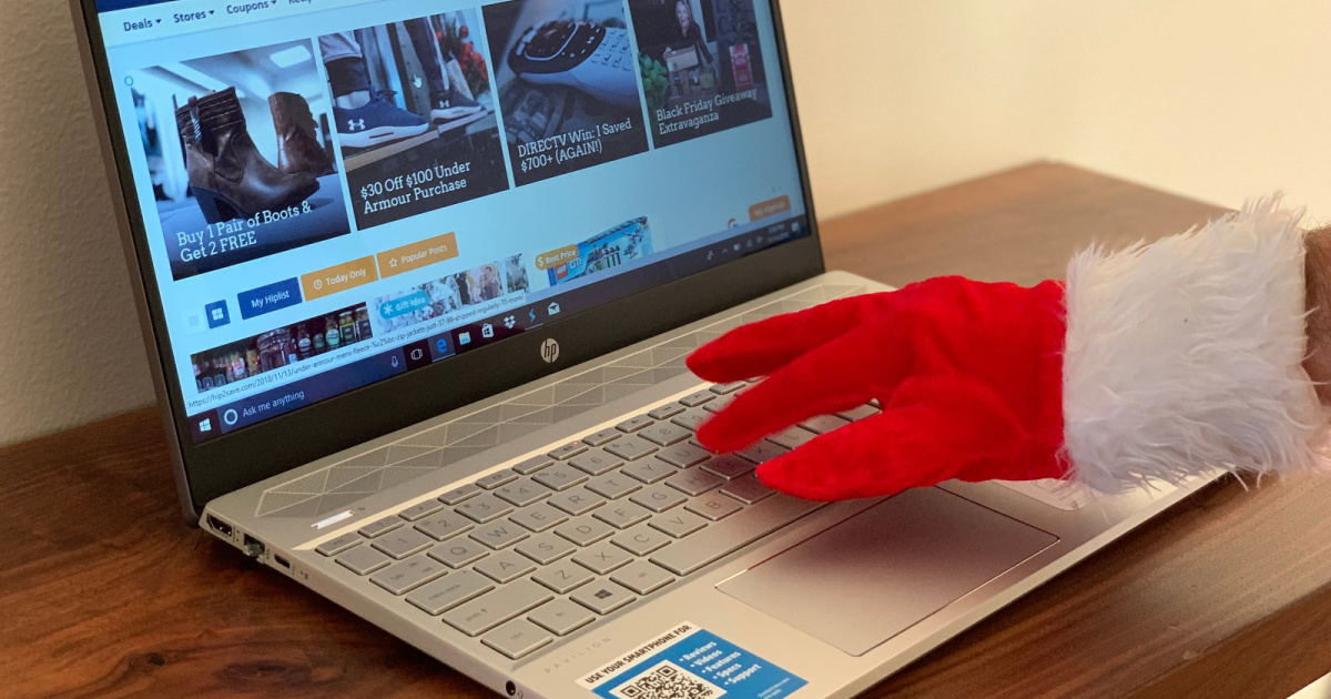 HP black friday deals - laptop with Christmas hand