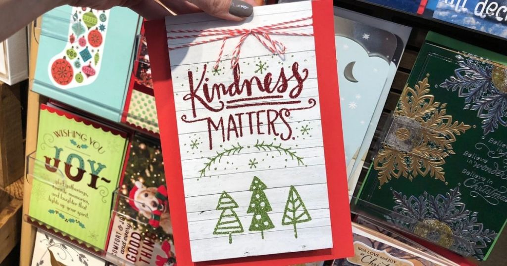 Hallmark Christmas card in woman's hand