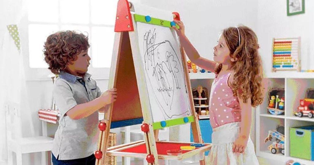 kids working at hape artist easel