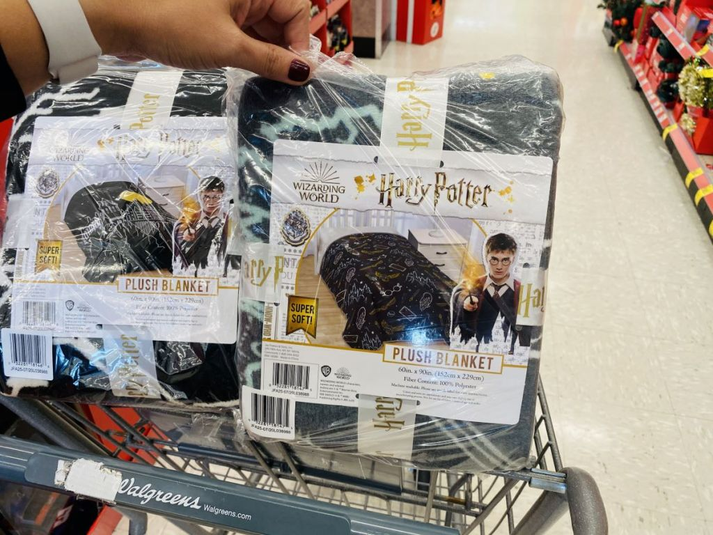 hand holding a Harry Potter blanket in a package
