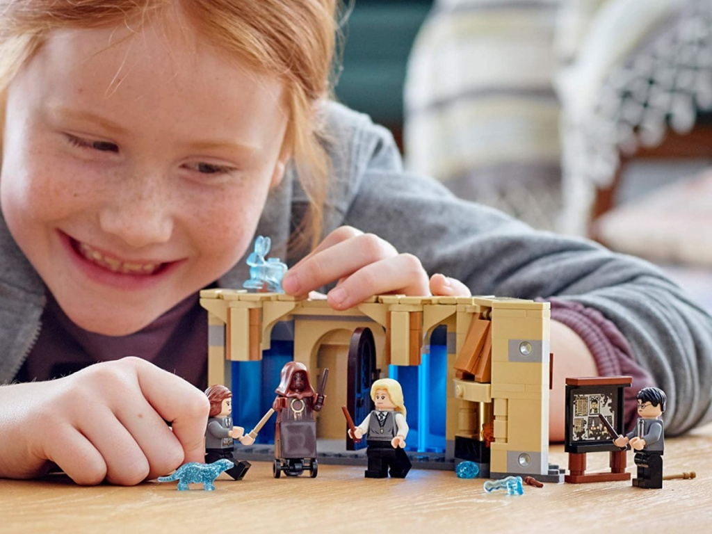 Girl playing with LEGO set