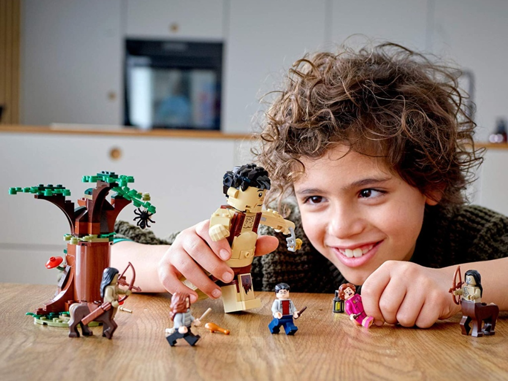 Boy playing with LEGOs on table