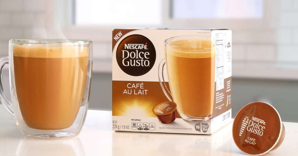 nescafe pods next to a box and coffee cup
