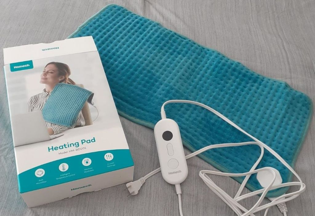 Homech heating pad next to the box