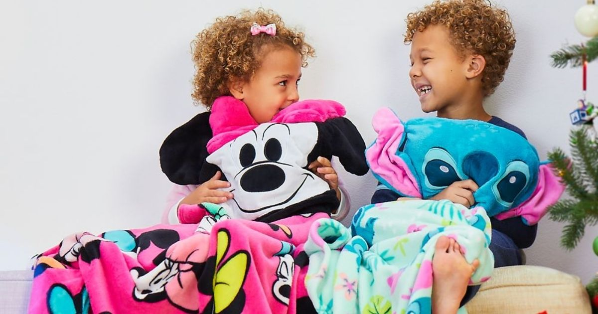 boy and girl with disney hooded throws
