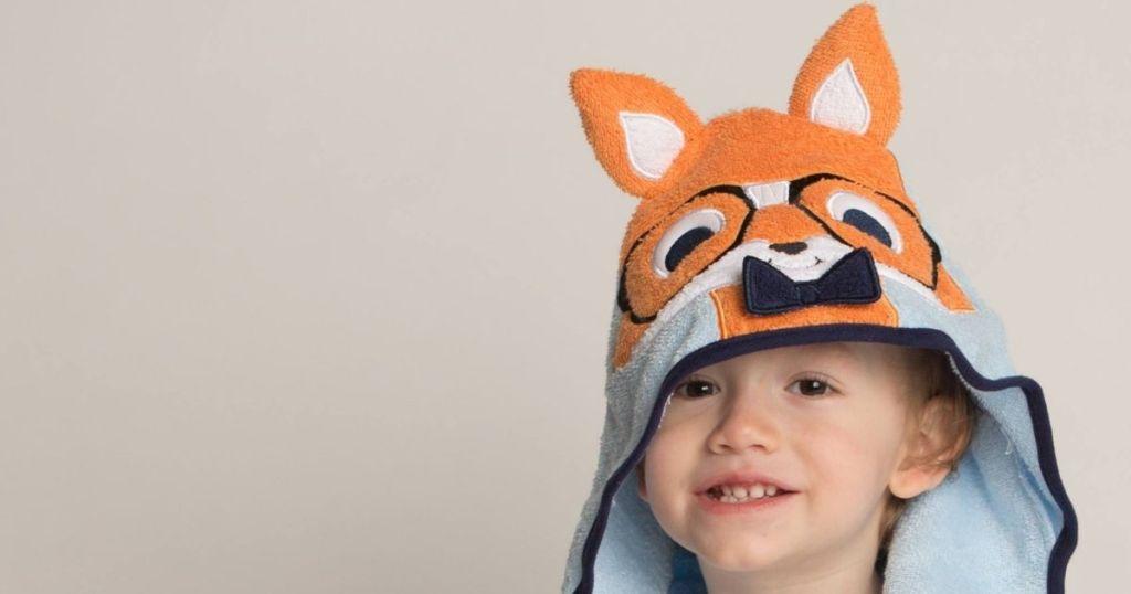 boy wearing a fox towel