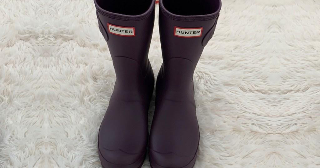 women's purple matte rain boots on white fur
