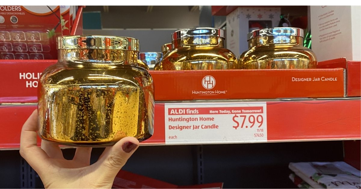 hand holding a gold glass jar candle in ALDI