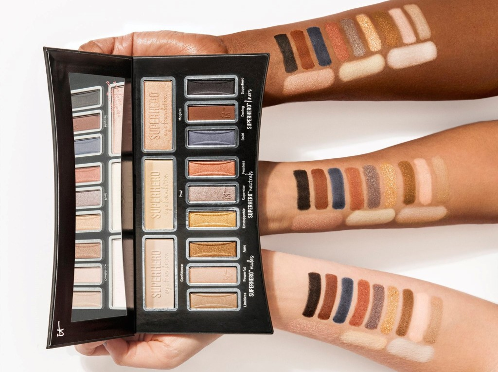 three hands holding a makeup palette