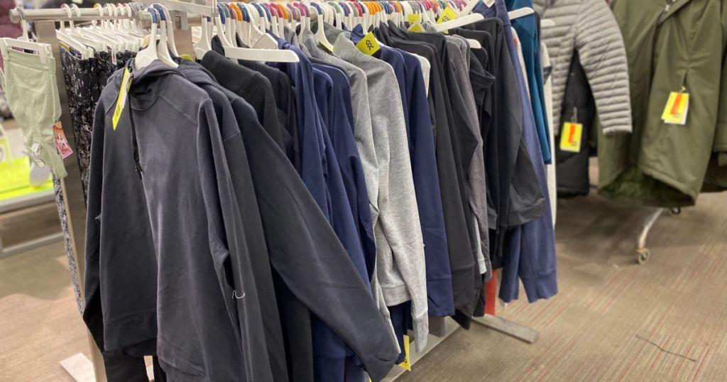 jackets hanging on rod