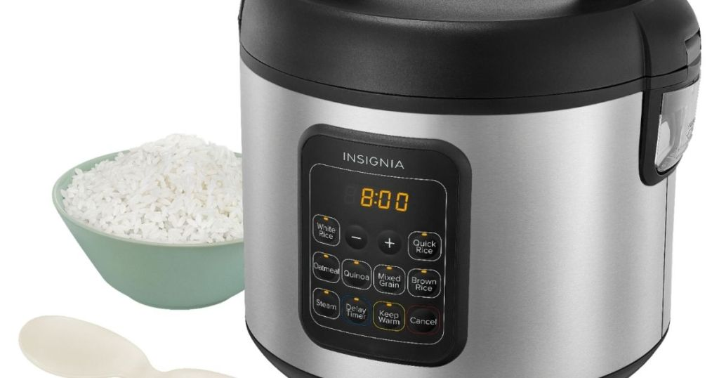 rice cooker with a bowl of rice next to it