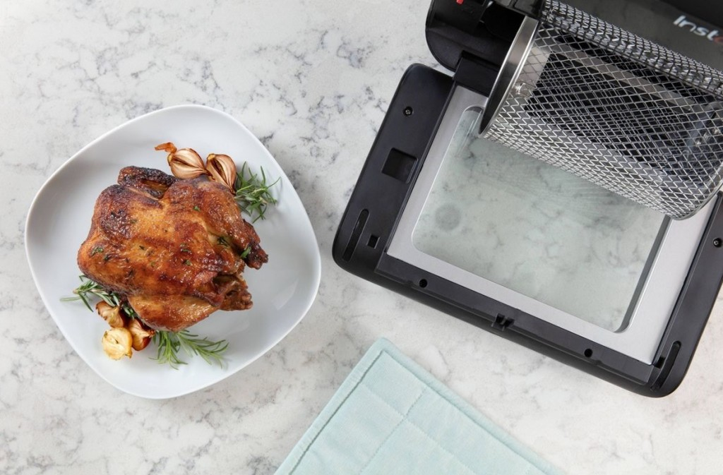 air fryer with a chicken next to it