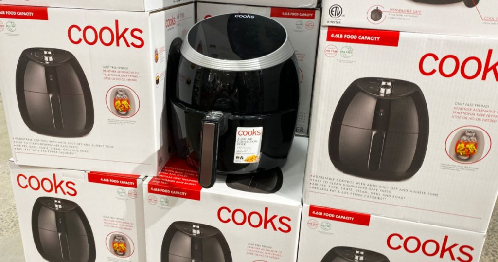 black air fryer on top of white boxes of cooks brand air fryers at JCPenney