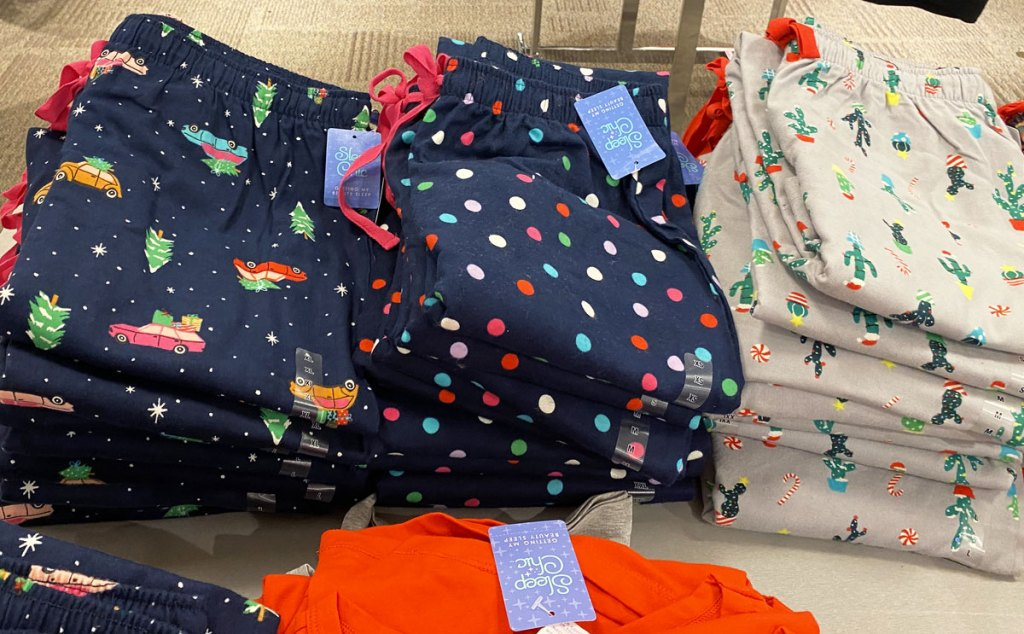 folded stacks of women's holiday print pajama pants at JCPenney