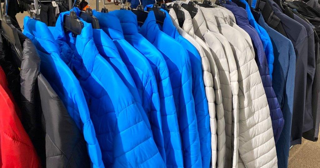 rack of blue and light grey puffer jackets