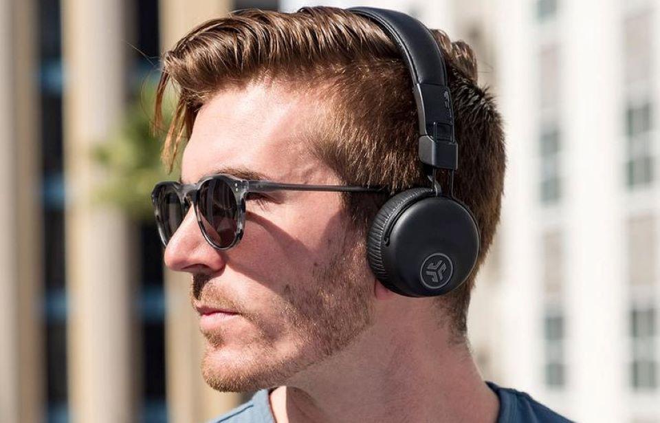 man wearing headphones and sunglasses