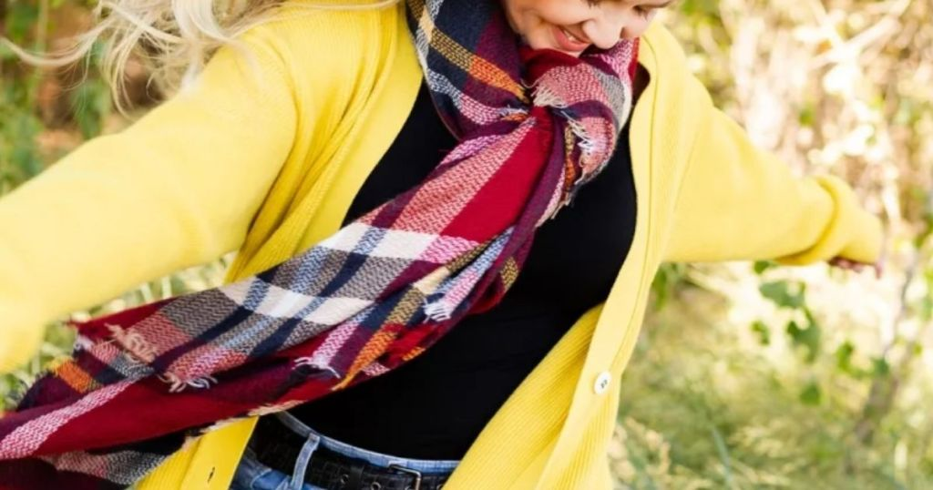 Girl in yellow jacket with Jane Monogram Scarf Red