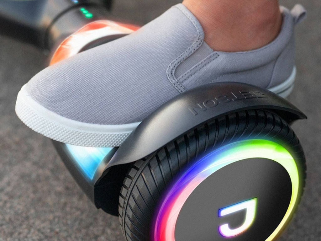 kids foot on black hoverboard with light up wheels