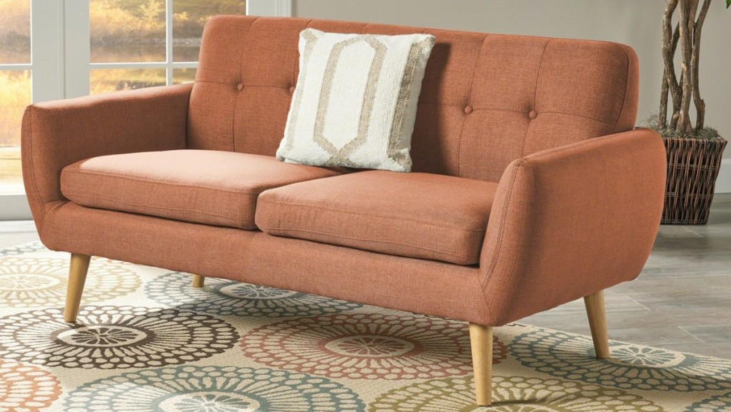 sofa with a pillow on it