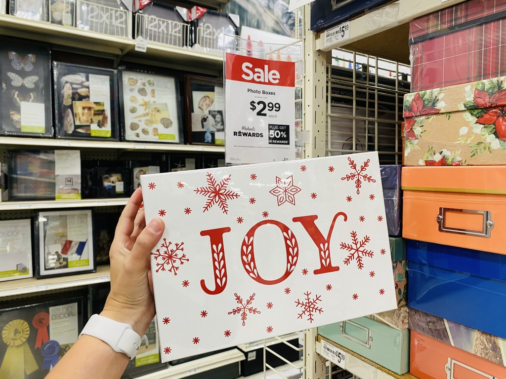 woman holding Joy Photo Box in store