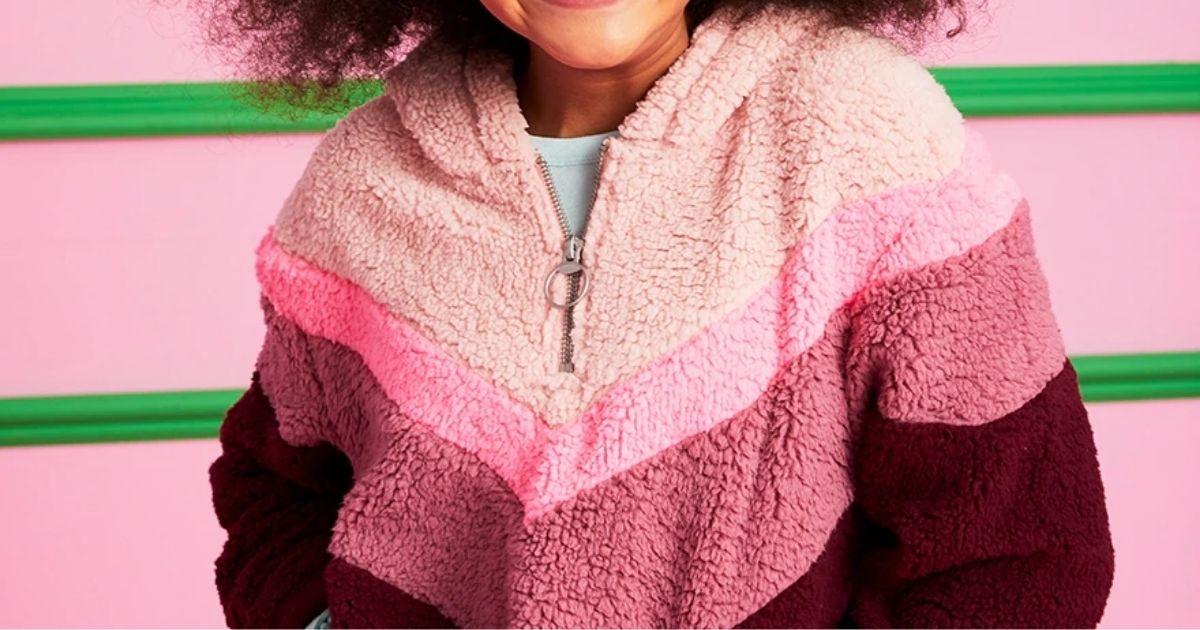 girl wearing pink Justice Sherpa
