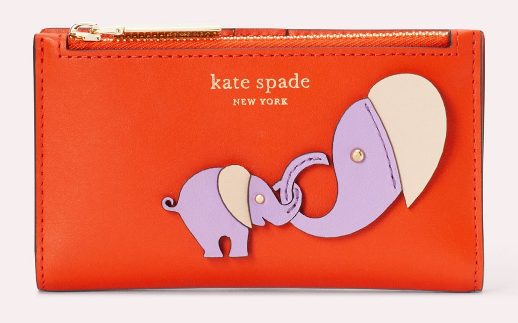 red wallet with zipper on top with pruple mother and baby elephant holding trunks