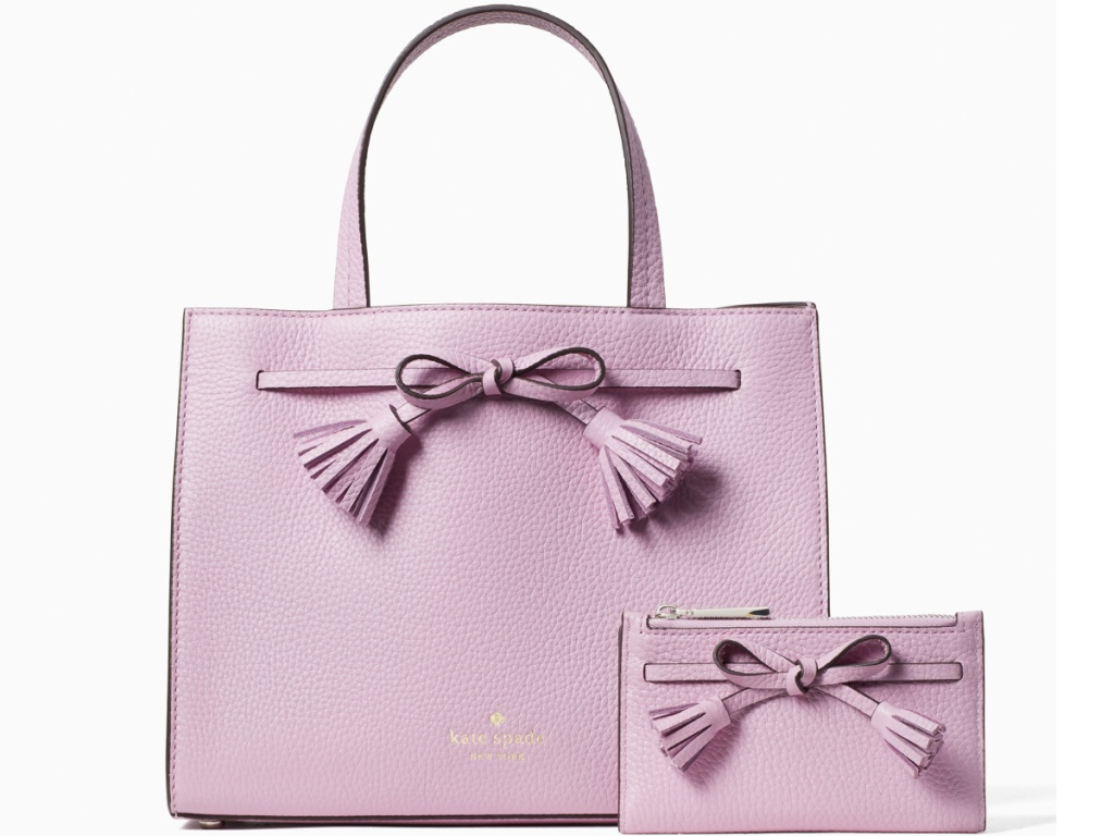 pale pink kate spade tote bag and wallet with bows on front