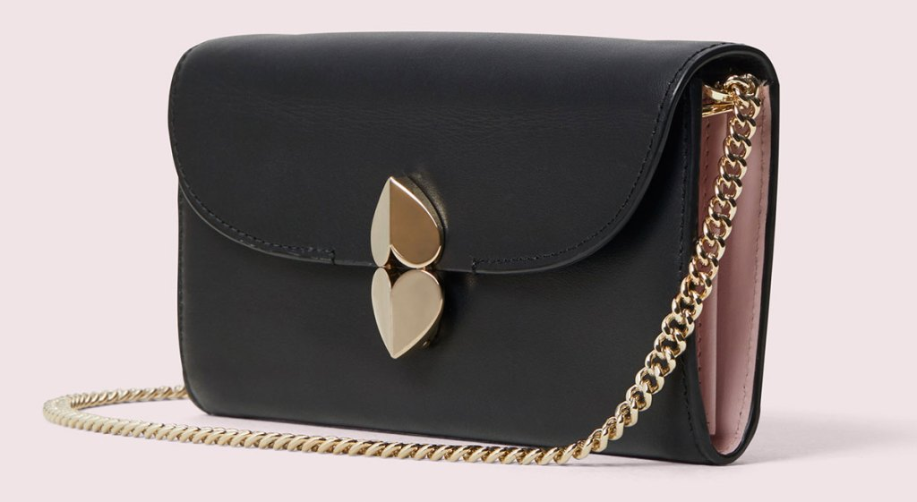 black crossbody bag with gold double heart closure and gold chain strap