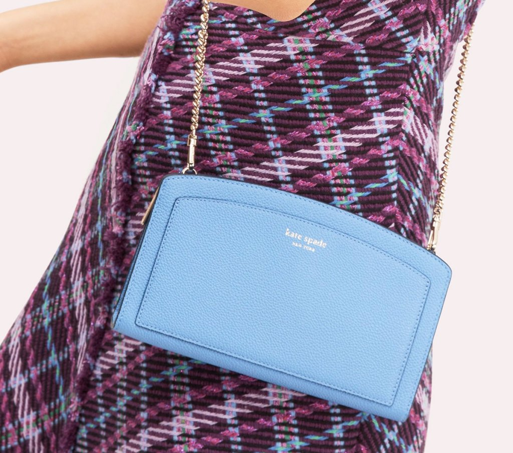woman in black and purple plaid dress with blue crossbody kate spade bag with gold chain