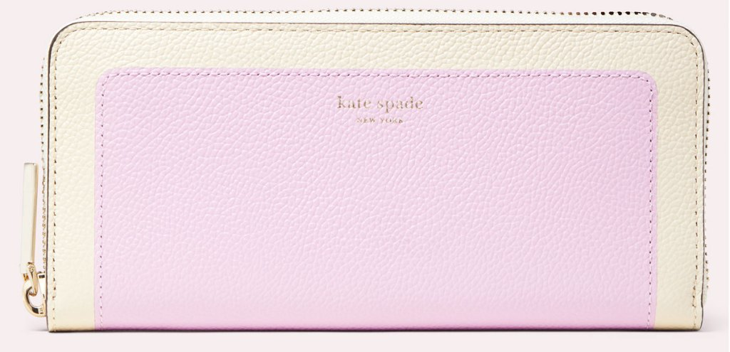 cream and lilac colorblock kate spade zip-around wallet
