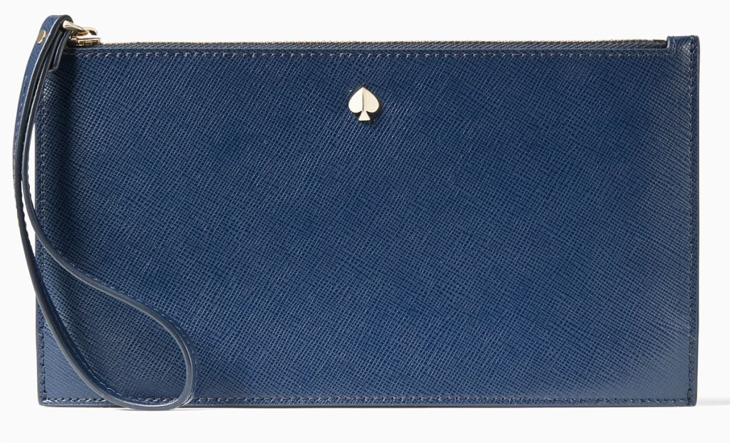 navy blue wristlet with small gold kate spade logo at top center