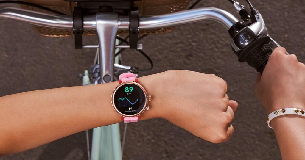 woman wearing a Kate Spade New York Women's Scallop Smartwatch
